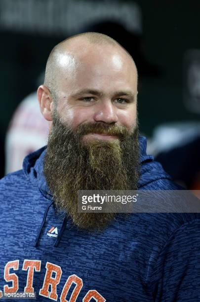 Evan Gattis of the Houston Astros sits in the dugout before the game against the Baltimore Orioles at Oriole Park at Camden Yards on September 28,...