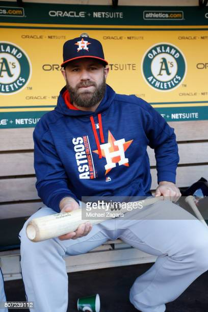 Evan Gattis of the Houston Astros sits in the dugout prior to the game against the Oakland Athletics at the Oakland Alameda Coliseum on June 21 2017...