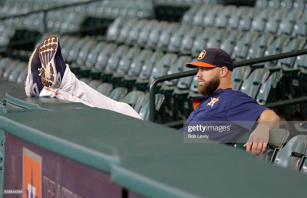 Evan Gattis #11 of the Houston Astros waits for batting practice to start at Minute Maid Park on July 8, 2016 in Houston, Texas.