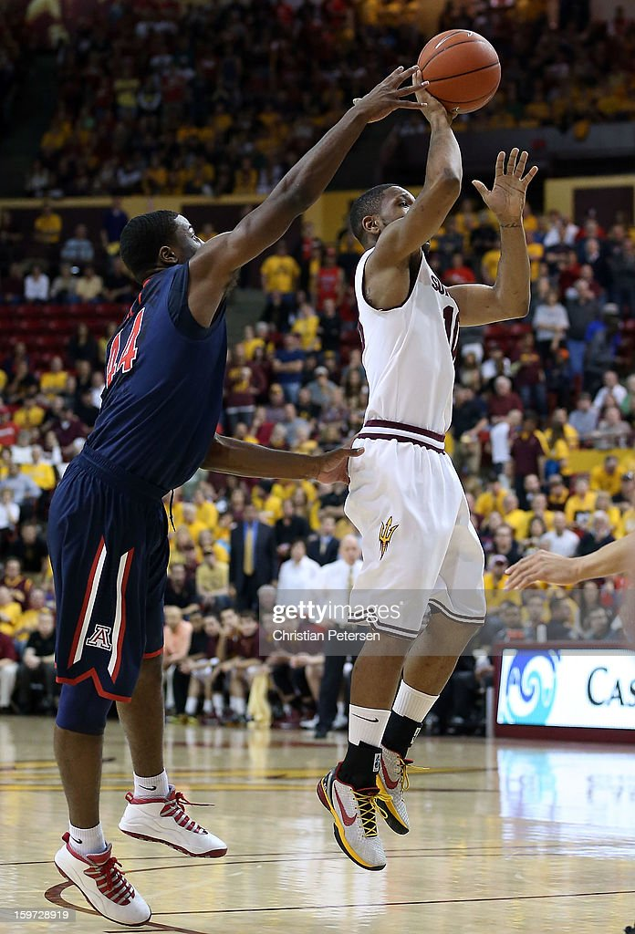 Evan Gordon #10 of the Arizona State Sun Devils attempts a shot under pressure from Solomon Hill #44 of the Arizona Wildcats during the college basketball game at Wells Fargo Arena on January 19, 2013 in Tempe, Arizona. The Wildcats defeated the Sun Devils 71-54.