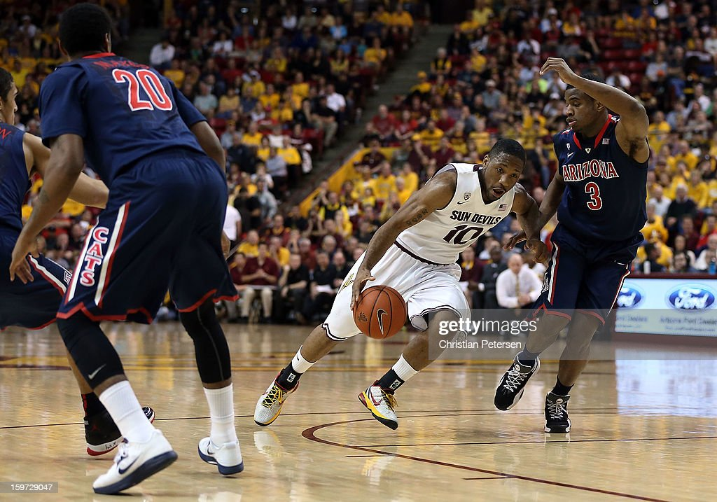 Evan Gordon #10 of the Arizona State Sun Devils drives the ball past Kevin Parrom #3 of the Arizona Wildcats during the college basketball game at Wells Fargo Arena on January 19, 2013 in Tempe, Arizona. The Wildcats defeated the Sun Devils 71-54.