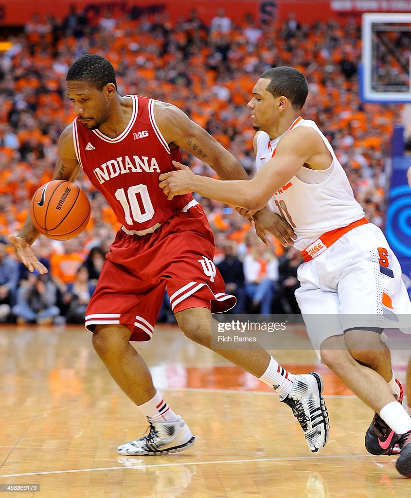 Evan Gordon #10 of the Indiana Hoosiers reaches for a loose ball as Tyler Ennis #11 of the Syracuse Orange defends during the second half at the Carrier Dome on December 3, 2013 in Syracuse, New York. Syracuse defeated Indiana 69-52.
