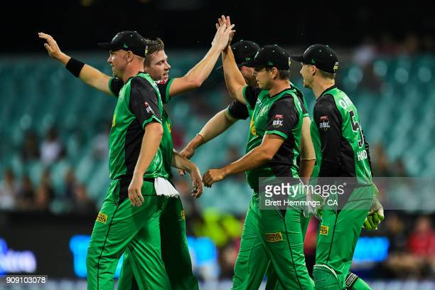Evan Gulbis of the Stars celebrates with team mates after taking a catch to dismiss Daniel Hughes of the Sixers during the Big Bash League match...
