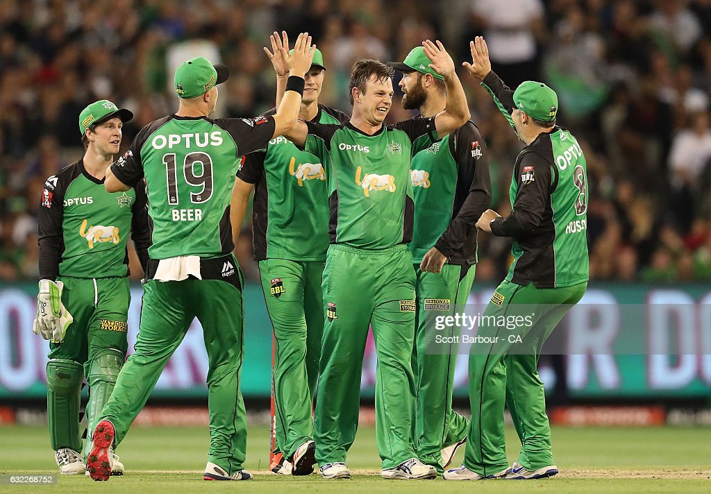 Evan Gulbis of the Stars is congratulated by his teammates after dismissing Daniel Hughes of the Sixers during the Big Bash League match between the Melbourne Stars and the Sydney Sixers at the Melbourne Cricket Ground on January 21, 2017 in Melbourne, Australia.