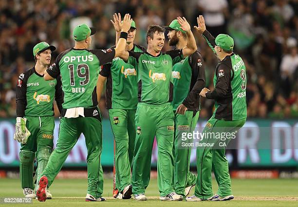 Evan Gulbis of the Stars is congratulated by his teammates after dismissing Daniel Hughes of the Sixers during the Big Bash League match between the...