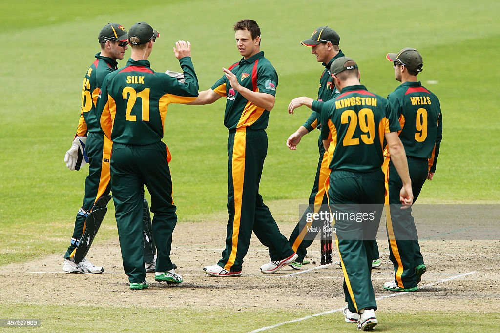 Evan Gulbis (C) of the Tigers celebrates with team mates after taking the wicket of Timothy Davey of the Redbacks during the Matador BBQs One Day Cup match between Tasmania and South Australia at North Sydney Oval on October 22, 2014 in Sydney, Australia.