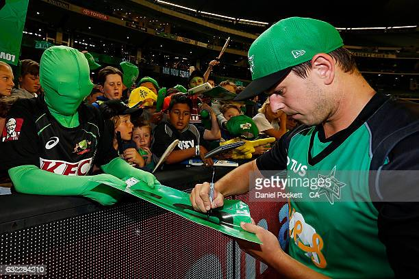Evan Gulbis signs autographs after the Big Bash League match between the Melbourne Sixers and the Adelaide Sixers at Melbourne Cricket Ground on...