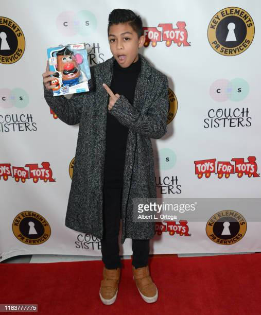 Evan Hernandez attends The Couch Sisters 1st Annual Toys For Tots Toy Drive held onNovember 20 2019 in Glendale California