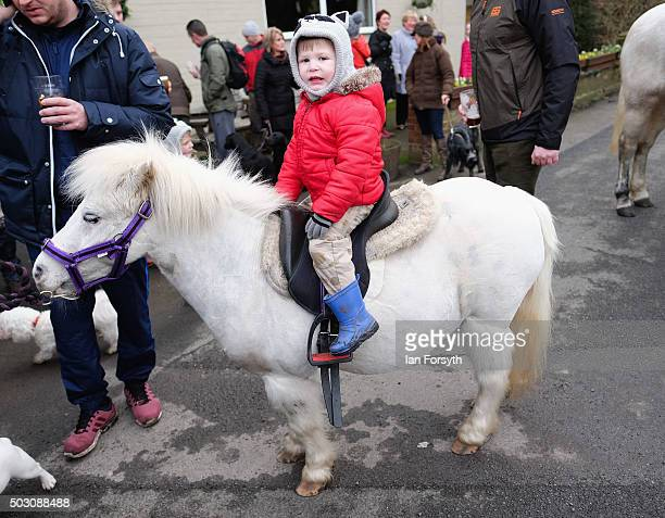 Evan Hood from Boosbeck sits on his pony as horses, riders and hounds from the Cleveland Hunt prepare to ride out on the traditional New Year's Day...