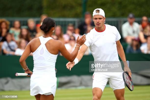 Evan Hoyt and Eden Silva of Great Britain celebrate in their Mixed Doubles first round match against Divij Sharan of India and Yingying Duan of China...