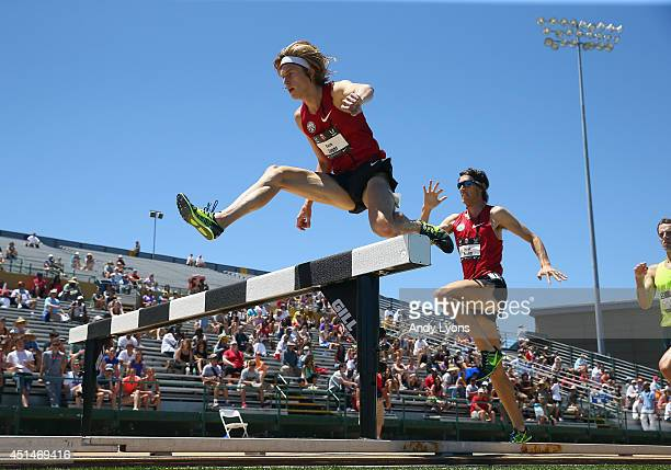 Evan Jager clears a hurdle on his way to victory in the Men's 3000 Meter Steeplechase on day 5 of the USATF Outdoor Championships at Hornet Stadium...