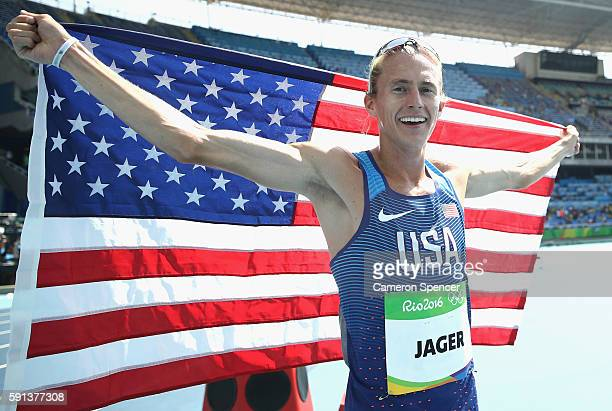 Evan Jager of the United States celebrates with the American flag after winning the silver medal in the Men's 3000m Steeplechase Final on Day 12 of...