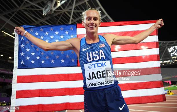 Evan Jager of the United States celebrates with the American flag after winning bronze in the Men's 3000 metres Steeplechase final during day five of...