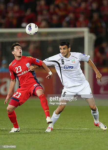 Evan Kostopoulos of Adelaide and Anvar Gafurov fights for the ball during the AFC Champions League Quarter Final match between Adelaide United and...