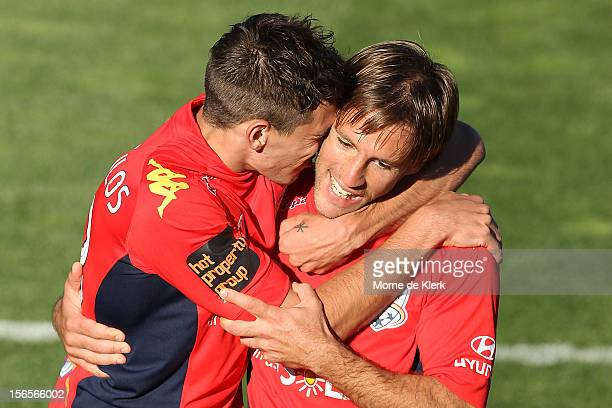Evan Kostopoulos of Adelaide congratulates team mate Jeronimo Neumann after he scored a goal during the round seven ALeague match between Adelaide...