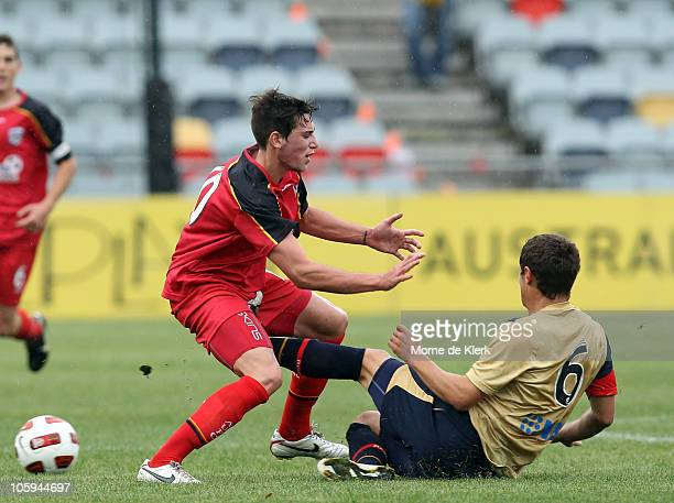 Evan Kostopoulos of Adelaide gets kicked in the groin by Samuel Gallaway of the Jets during a round six Youth League match between Adelaide United...