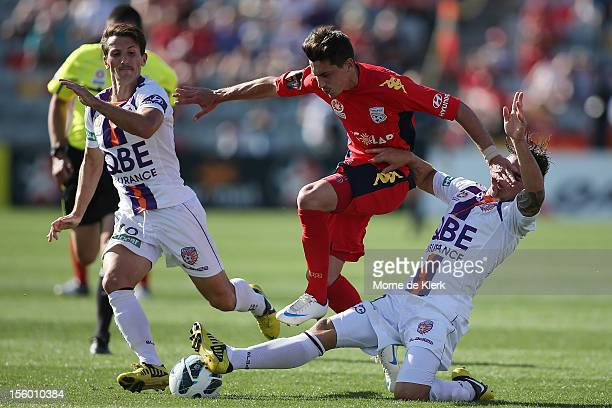 Evan Kostopoulos of Adelaide is tackled by Joshua Risdon of Perth during the round six A-League match between Adelaide United and the Perth Glory at...