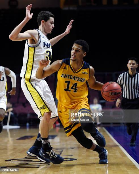 Evan Leonard of the UC Irvine Anteaters drives against Chris Bowling of the Northern Arizona Lumberjacks during the 2017 Continental Tire Las Vegas...