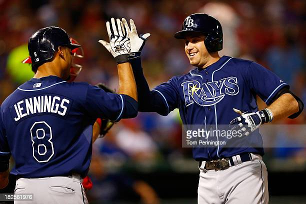Evan Longoria celebrates with Desmond Jennings of the Tampa Bay Rays after hitting a tworun homerun in the third inning against the Texas Rangers in...