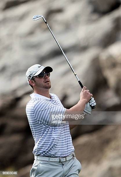 Evan Longoria hits a tee shot on the 14th hole during the first round of the Bob Hope Classic at the Silver Rock Resort on January 20 2010 in La...