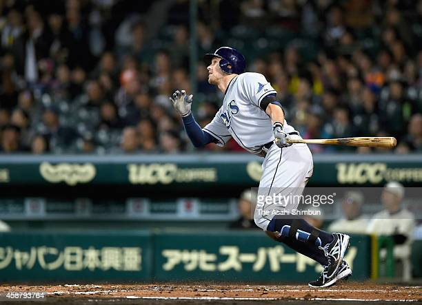 Evan Longoria of Tampa Bay Rays hits a grand slam in the top of 5th inning during the friendly match between Yomiuri Giants Hanshin Tigers and MLB...