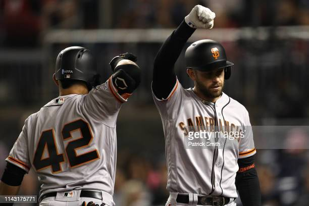 Evan Longoria of the San Francisco Giants celebrates after hitting a home run against the Washington Nationals during the fifth inning at Nationals...