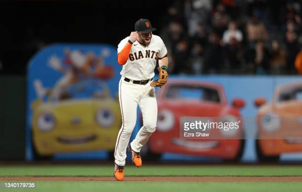 Evan Longoria of the San Francisco Giants celebrates after the Giants beat the San Diego Padres to clinch a playoff birth at Oracle Park on September...