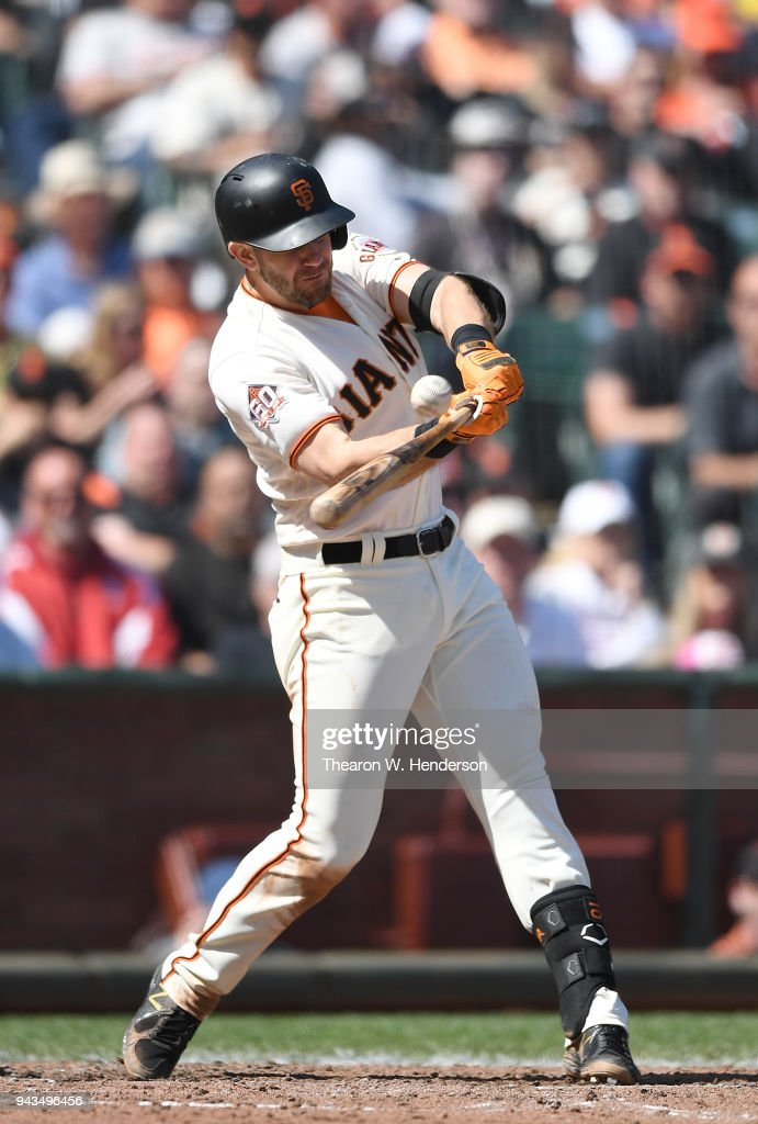 Evan Longoria #10 of the San Francisco Giants hits a double against the Los Angeles Dodgers in the bottom of the seventh inning at AT&T Park on April 8, 2018 in San Francisco, California.