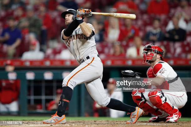 Evan Longoria of the San Francisco Giants hits a solo home run to break a tie game in the 11th inning against the Cincinnati Reds at Great American...
