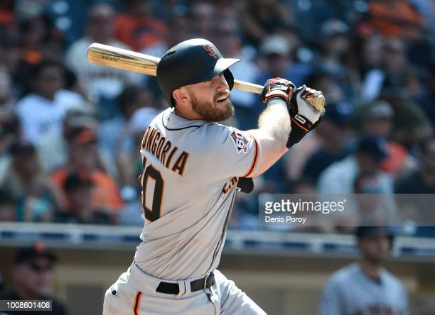 Evan Longoria of the San Francisco Giants hits a triple during the tenth inning of a baseball game against the San Diego Padres PETCO Park on July...