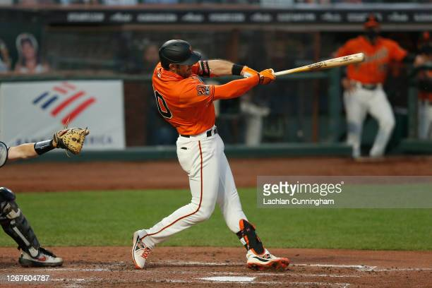 Evan Longoria of the San Francisco Giants hits a two-run home run in the bottom of the third inning against the Arizona Diamondbacks at Oracle Park...