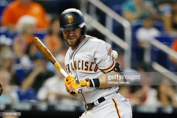 Evan Longoria of the San Francisco Giants is hit by a pitch in the fourth inning against the Miami Marlins at Marlins Park on May 30, 2019 in Miami,...