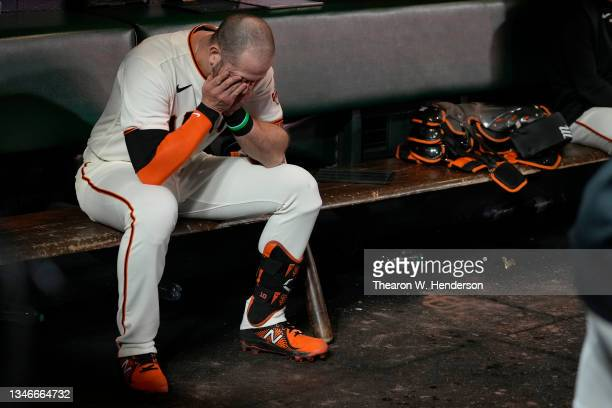 Evan Longoria of the San Francisco Giants reacts after losing to the Los Angeles Dodgers 2-1 in game 5 of the National League Division Series at...