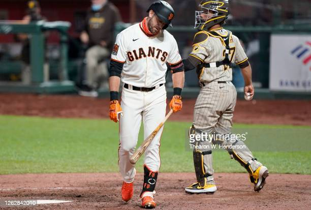 Evan Longoria of the San Francisco Giants reacts after striking out with the bases loaded against the San Diego Padres in the bottom of the seventh...