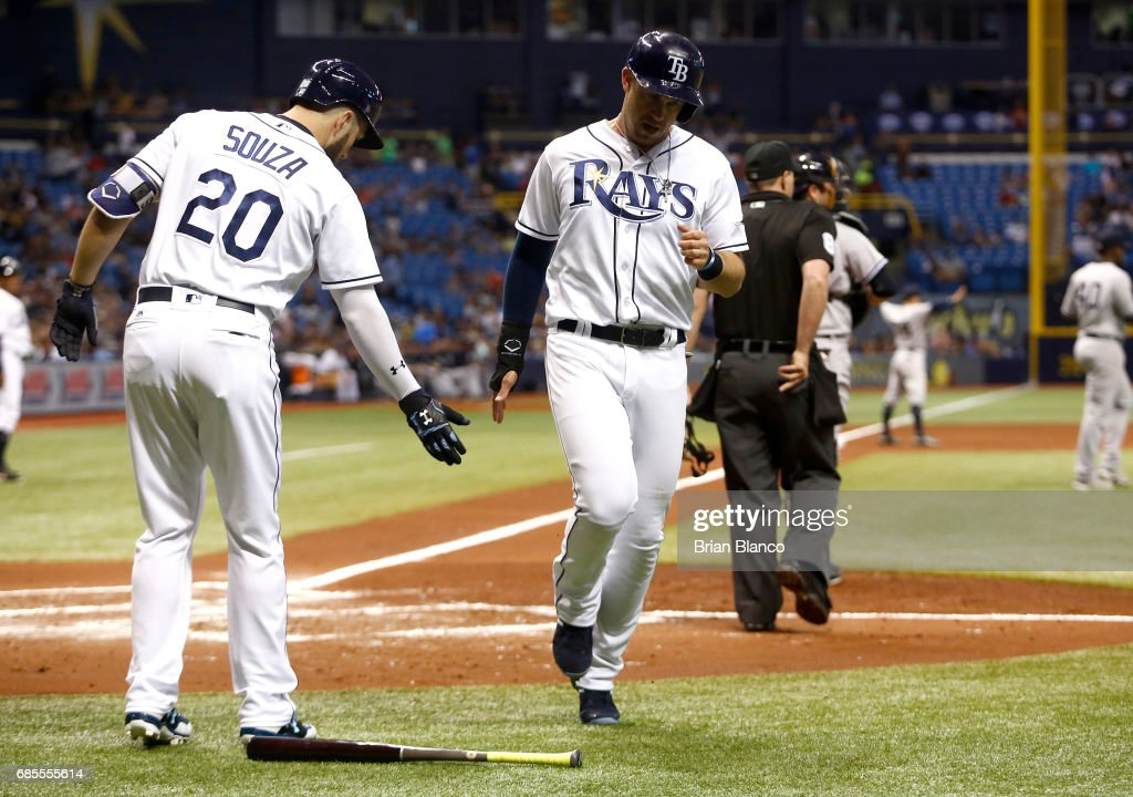 Evan Longoria #3 of the Tampa Bay Rays celebrates at home plate with Steven Souza Jr. #20 after scoring off of the RBI double by Logan Morrison during the first inning of a game against the New York Yankees on May 19, 2017 at Tropicana Field in St. Petersburg, Florida.