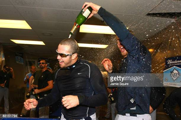 Evan Longoria of the Tampa Bay Rays celebrates with teammates in the locker room after their 62 win against the Chicago White Sox in Game Four of the...
