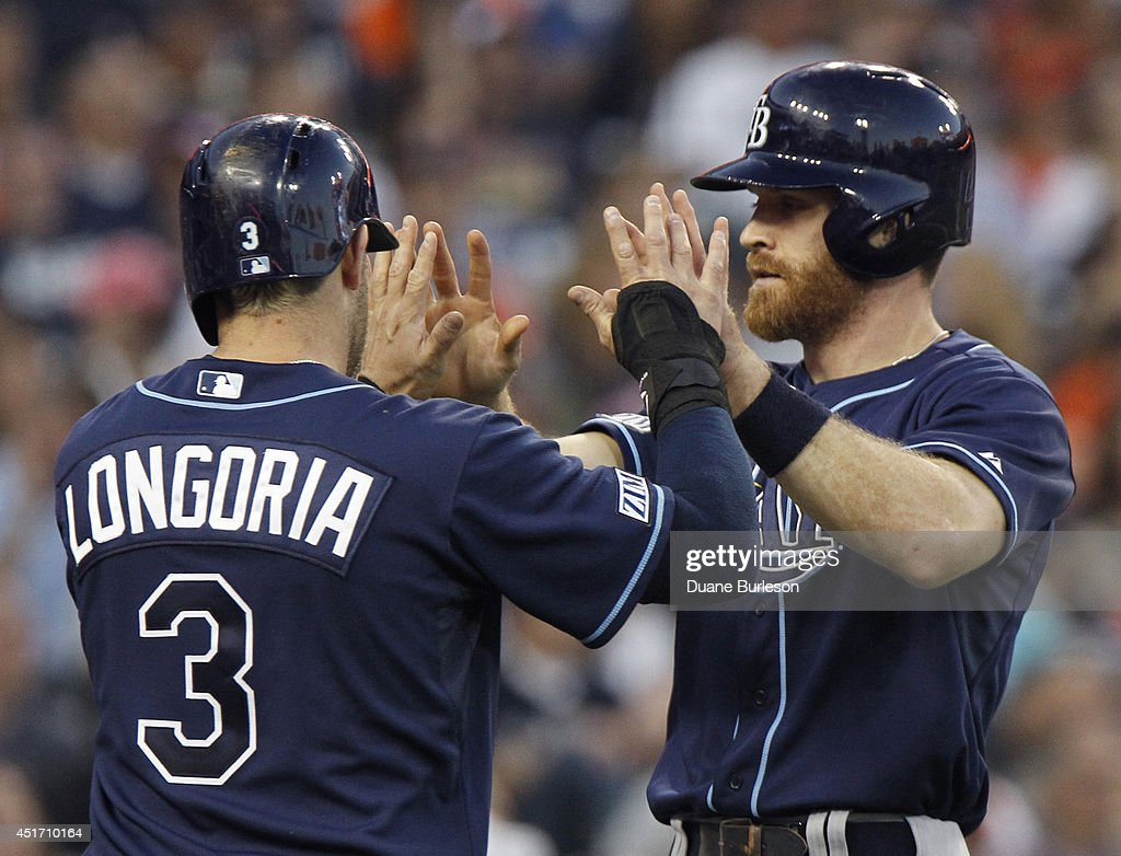 Evan Longoria #3 of the Tampa Bay Rays high-fives with Logan Forsythe #10 after they scored against the Detroit Tigers on a triple by Sean Rodriguez during the sixth inning at Comerica Park on July 4, 2014 in Detroit, Michigan.