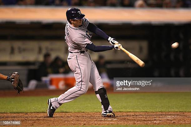 Evan Longoria of the Tampa Bay Rays hits a solo home run against the Oakland Athletics in the sixth inning during an MLB game at the Oakland-Alameda...