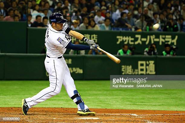 Evan Longoria of the Tampa Bay Rays hits a solo home run in the sixth inning during the game four of Samurai Japan and MLB All Stars at Tokyo Dome on...