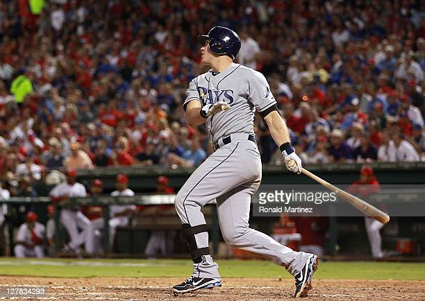 Evan Longoria of the Tampa Bay Rays hits a threerun home run against the Texas Rangers in the 7th inning during Game Two of the American League...