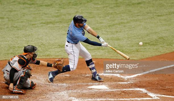 Evan Longoria of the Tampa Bay Rays hits a threerun home run in front of catcher Caleb Joseph of the Baltimore Orioles during the fifth inning of a...