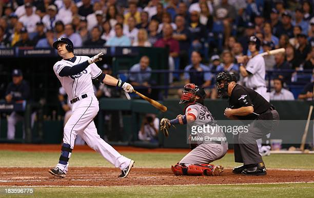 Evan Longoria of the Tampa Bay Rays hits a threerun home run in the fifth inning against the Boston Red Sox during Game Three of the American League...