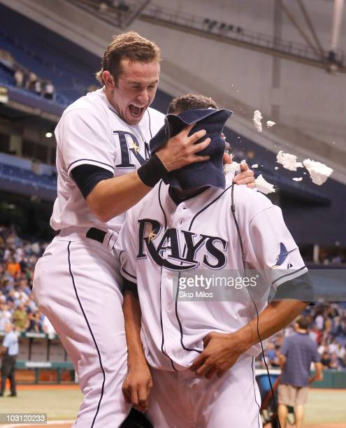 Evan Longoria of the Tampa Bay Rays pushes a shaving cream pie into the face of teammate Matt Garza in celebration of Garza pitching a nohitter in...