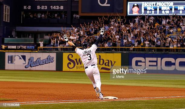 Evan Longoria of the Tampa Bay Rays rounds the bases after his gamewinning walk off home run in the twelfth inning against the New York Yankees...