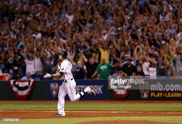 Evan Longoria of the Tampa Bay Rays rounds the bases after hitting a threerun home run in the fifth inning against the Boston Red Sox during Game...