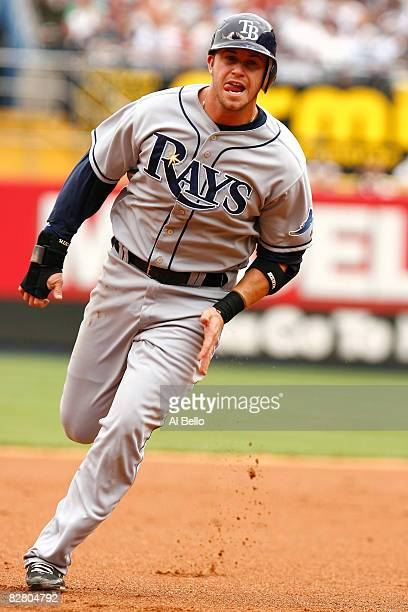 Evan Longoria of the Tampa Bay Rays rounds the bases to score in the second inning against the New York Yankees during the first game of a day-night...