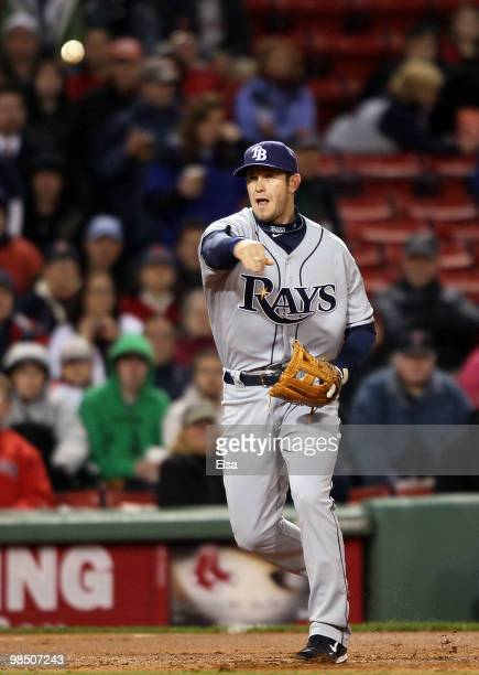 Evan Longoria of the Tampa Bay Rays sends the ball to first for the out against the Boston Red Sox on April 16, 2010 at Fenway Park in Boston,...