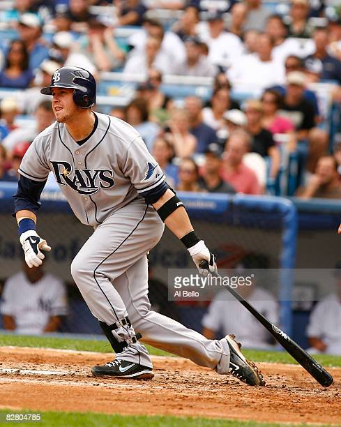 Evan Longoria of the Tampa Bay Rays singles and drives in two runs in the fifth inning against the New York Yankees during the first game of a...