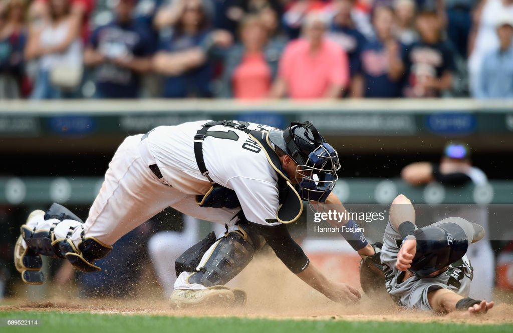 Evan Longoria #3 of the Tampa Bay Rays slides safely past Jason Castro #21 of the Minnesota Twins to score a run during the ninth inning of the game on May 28, 2017 at Target Field in Minneapolis, Minnesota. The Rays defeated the Twins 8-6 in fifteen innings.