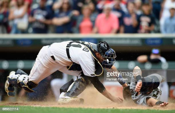 Evan Longoria of the Tampa Bay Rays slides safely past Jason Castro of the Minnesota Twins to score a run during the ninth inning of the game on May...